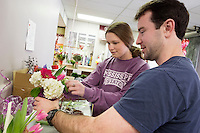 Junior horticulture/floral management major Abigale G. &ldquo;Abby&rdquo; Jenkins of Cedar Park, Texas, helps Mississippi State senior management major Austin M. McCann of Memphis, Tennessee, to make his own Valentine floral arrangement Friday [Feb. 12] at The University Florist. Jenkins, president of the university&rsquo;s Student Chapter of the American Institute of Floral Designers, is among the students who are on hand today [Feb. 13] from 10 a.m. to 2 p.m. to assist individuals and groups with creating their own Valentine&rsquo;s Day arrangements. Groups may call 662-325-3585 to reserve a time. All participants will earn a discount on their purchase with the make-your-own option and help support SAIFD's trip to the Southern regional competition this spring. Located at 100 Lee Blvd., The University Florist also will be open on Sunday from noon to 3 p.m. to assist patrons with all of their Valentine's Day gift and floral needs, including the new Bulldog plush line and an assortment of Valentine candy. Arrangements of roses, tulips, hydrangeas and gerberas are featured at the shop, and a new shipment of McCartys Pottery arrived this week.<br />