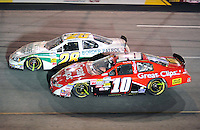 May 1, 2009; Richmond, VA, USA; NASCAR Nationwide Series driver Brian Scott (10) races alongside Kenny Wallace during the Lipton Tea 250 at the Richmond International Raceway. Mandatory Credit: Mark J. Rebilas-