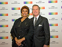 Former United States Secretary of Defense William S. Cohen and his wife, and his wife, author Janet Langhart Cohen, arrive for the formal Artist's Dinner honoring the recipients of the 40th Annual Kennedy Center Honors hosted by United States Secretary of State Rex Tillerson at the US Department of State in Washington, D.C. on Saturday, December 2, 2017. The 2017 honorees are: American dancer and choreographer Carmen de Lavallade; Cuban American singer-songwriter and actress Gloria Estefan; American hip hop artist and entertainment icon LL COOL J; American television writer and producer Norman Lear; and American musician and record producer Lionel Richie. Photo Credit: Ron Sachs/CNP/AdMedia
