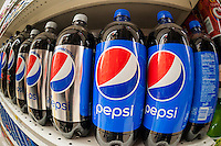 Bottles of Pepsi in a grocery store in New York on Monday, February 8, 2016. PepsiCo will report results for its fourth-quarter earnings on Thursday, before the exchange opens, and analysts are expecting an increase in earnings driven by Pepsico's snack unit. (© Richard B. Levine)