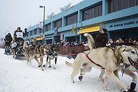 Paige Drobny leaves the Anchorage ceremonial start of the Iditarod sled dog race Anchorage Saturday, March 2, 2013. ..Photo (C) Jeff Schultz/IditarodPhotos.com  Do not reproduce without permission