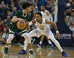 Colorado State's Anthony Bonnner dribbles against Nevada's Hallice Cooke in the first half of an NCAA college basketball game in Reno, Nev., Sunday, Feb. 25, 2018. (AP Photo/Tom R. Smedes)