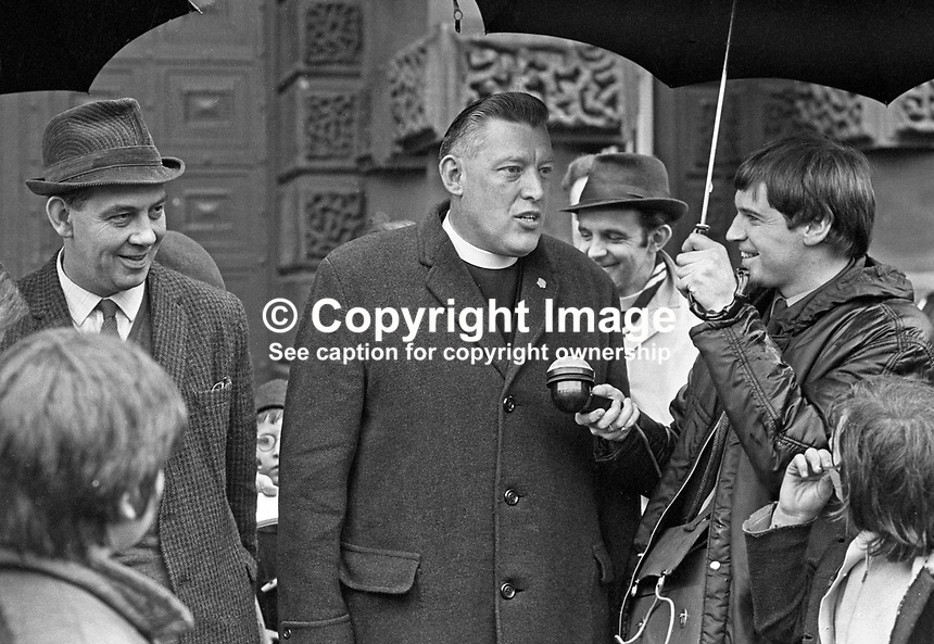 Rev Ian Paisley being interviewed outside Crumlin Road Jail, Belfast, N Ireland, UK, on his release from prison following a government amnesty for anyone convicted of or still to be charged with a civil disorder offence that had occurred since October 1968. Also in the photograph is Major Ronald Bunting who was released at the same time. 196905060172b. The interviewer is Don Anderson, BBC Belfast.<br /> <br /> Copyright Image from Victor Patterson, 54 Dorchester Park, <br /> Belfast, UK, BT9 6RJ<br /> <br /> t1: +44 28 9066 1296 (from Rep of Ireland 048 9066 1296)<br /> t2: +44 28 9002 2446 (from Rep of Ireland 048 9002 2446)<br /> m: +44 7802 353836<br /> <br /> e1: victorpatterson@me.com<br /> e2: victorpatterson@gmail.com<br /> www.victorpatterson.com<br /> <br /> Please see my Terms and Conditions of Use at www.victorpatterson.com. It is IMPORTANT that you familiarise yourself with them.<br /> <br /> Images used on the Internet must be visibly watermarked i.e. &copy; Victor Patterson<br /> within the body of the image and copyright metadata must not be deleted. Images <br /> used on the Internet have a size restriction of 4kbs and will be chargeable at current<br />  NUJ rates unless agreed otherwise.<br /> <br /> This image is only available for the use of the download recipient i.e. television station, newspaper, magazine, book publisher, etc, and must not be passed on to any third <br /> party. It is also downloaded on condition that each and every usage is notified within 7 days to victorpatterson@me.com<br /> <br /> The right of Victor Patterson to be identified as the author is asserted in accordance with The Copyright Designs And Patents Act (1988).