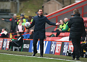24th March 2018, The Valley, London, England;  English Football League One, Charlton Athletic versus Plymouth Argyle; Plymouth Argyle manager Derek Adams protesting at the fourth official while holding the match ball on the touchline