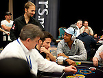 Team Pokerstars Pro Daniel Negreanu talks to fellow pro Phil Ivey.