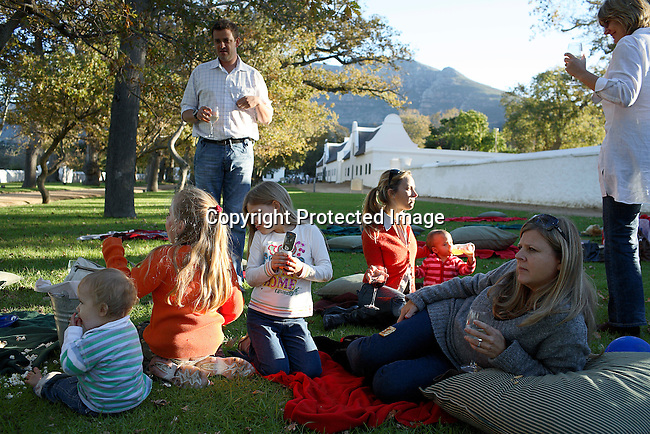 Affluent Capetonians celebrate a 1 year-old birthday party in the garden of Groot Constantia, the oldest vineyard estate in South Africa