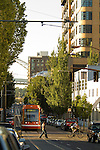 Cityscape of the Pearl District with Portland Streetcar and pedestrians.