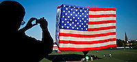 A man takes pictures of the World's Largest Free-Flying Flag Honors America special shaped hot balloon as preparation of America's birthday and Independence Day in Hoboken.  Photo by Eduardo Munoz Alvarez / VIEW..