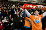 Blackpool 2 Liverpool 1, 12/01/2011. Bloomfield Road, Premier League. Home fans in the stands at Blackpool FC's Bloomfield Road stadium celebrating at the final whistle against Liverpool FC in a Premier League match. The home side won by two goals to one in front of a crowd of 16,089. It was the first time the clubs had met in a league match since Blackpool were last in the top division of English football in 1970-71. Photo by Colin McPherson.