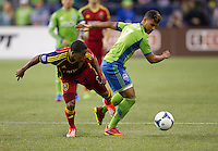 Joao Plata, left, of Real Salt Lake battles DeAndre Yedlin of the Seattle Sounders FC for the ball during play at CenturyLink Field in Seattle Friday September 13, 2013. The Sounders won the match 2-0.