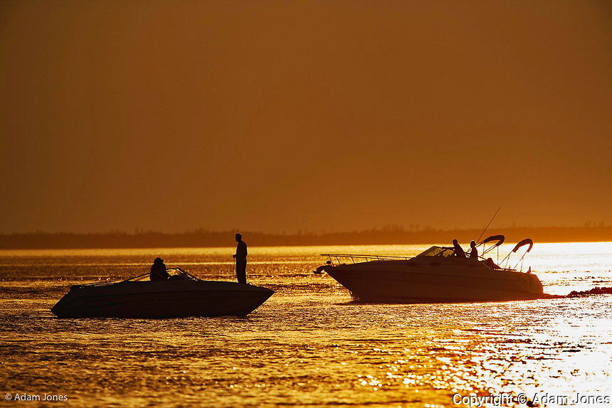 Two recreational boats passing at sunset, Sanibel Island, Florida