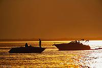 Two recreational boats passing at sunset, Sanibel Island, Florida