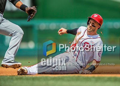 14 May 2016: Washington Nationals outfielder Bryce Harper steals third in the first inning during the first game of a double-header against the Miami Marlins at Nationals Park in Washington, DC. The Nationals defeated the Marlins 6-4 in the afternoon matchup.  Mandatory Credit: Ed Wolfstein Photo *** RAW (NEF) Image File Available ***