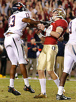TALLAHASSEE, FL 11/19/11-FSU-UVA111911 CH-Florida State's Dustin Hopkins is shoved by Virginia's Chase Minnifield after he missed the potential winning field goal in the final second of the game, Saturday at Doak Campbell Stadium in Tallahassee. The Seminoles lost to the Cavaliers 14-13..COLIN HACKLEY PHOTO