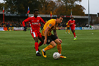 Martyn Woolford of Boston United and Kershaney Samuels of Carshalton Athletic during Carshalton Athletic vs Boston United, Emirates FA Cup Football at the War Memorial Sports Ground on 9th November 2019