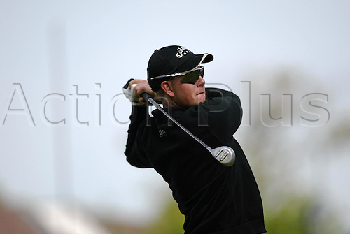 7 May 2004: Swedish golfer Henrik Stenson looks into the distance after playing a driver from a tee during the second round of the Daily Telegraph Damovo British Masters played at the Marriott Forest of Arden, Birmingham. Photo: Neil Tingle/Action Plus..040507 golf golfer golfers