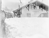 Passenger train stopped at snowy Cumbres depot.<br /> D&amp;RGW  Cumbres, CO