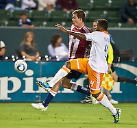 CARSON, CA – July 23, 2011: Chivas USA forward Justin Braun (17) and Houston Dynamo defender Jermaine Taylor (4) during the match between Chivas USA and Houston Dynamo at the Home Depot Center in Carson, California. Final score Chivas USA 3, Houston Dynamo 0.