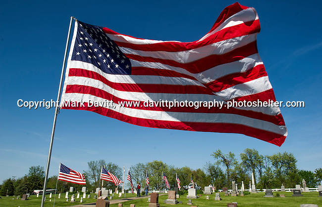 The Calvary Cemetery located west of Churchville is decorated in preparation for Memorial Day.
