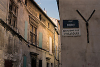 Historic buildings on the street corner of Rue Diderot, Arles, Provence, France.