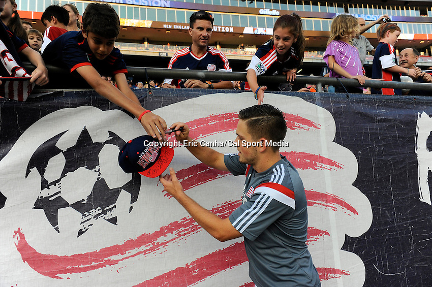 July 30, 2014 - Foxborough, Massachusetts, U.S. - New England Revolution's Kelyn Rowe (11) signs an autograph before the start of the MLS game between the Colorado Rapids and the New England Revolution held at Gillette Stadium in Foxborough Massachusetts. The New England Revolution defeated the Colorado Rapids 3-0. Eric Canha/CSM