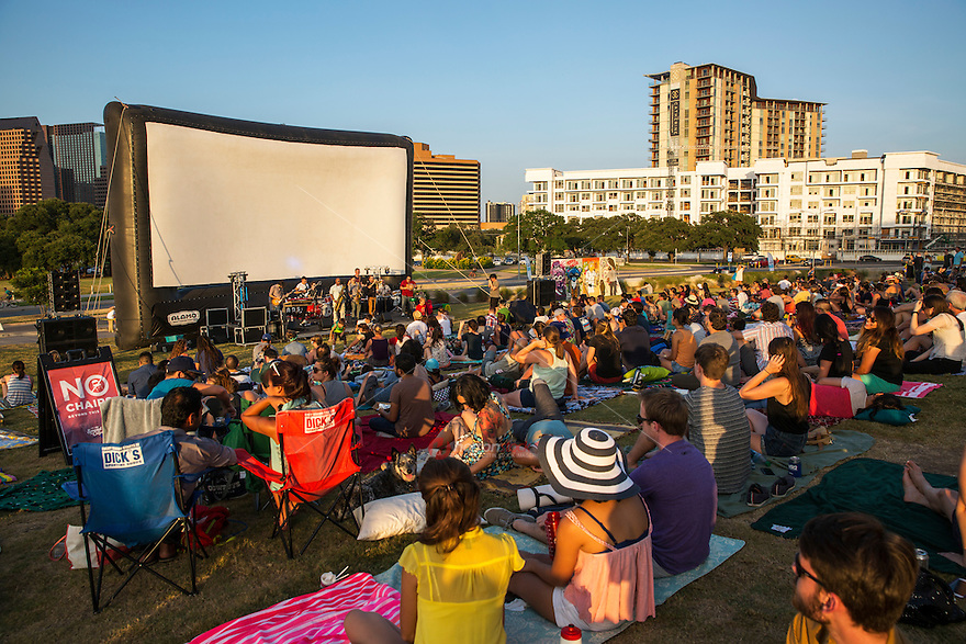 Summer lawn music and movies offer entertainment relief during Austin's 100+ degree weather, Austin's live outdoors movie and live music concert events. View from behind.