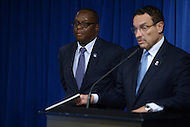 Washington, DC - September 25, 2014: Daniel Lucas (l) listens during a news conference as D.C. Mayor Vincent C. Gray announces Lucas as his nominee for D.C. Inspector General. Lucas has served as Deputy Inspector General for Naval Sea systems Command.  (Photo by Don Baxter/Media Images International)