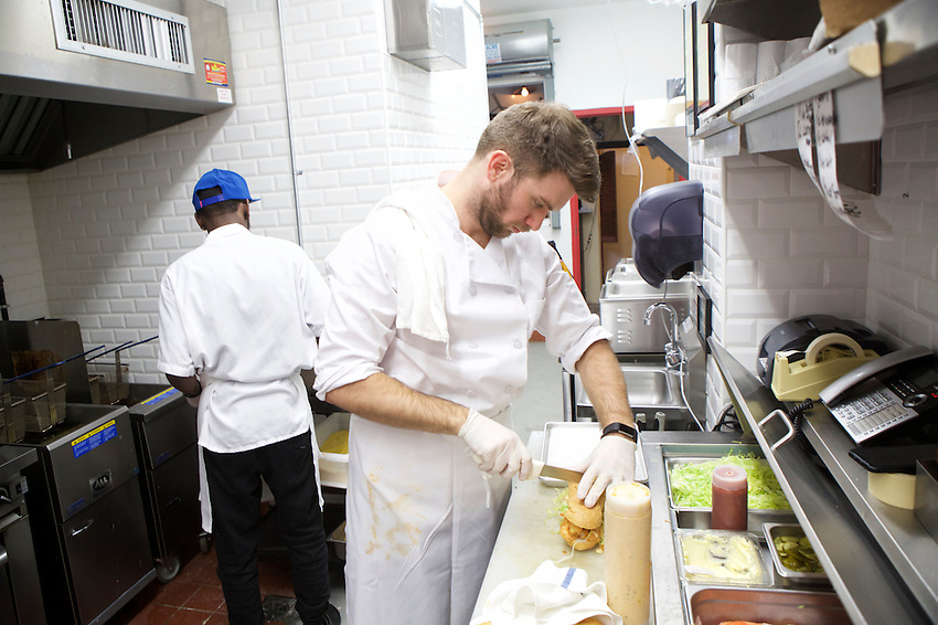 BROOKLYN, NY - January 28, 2017:  Chef Adam Lathan in the kitchen at The Gumbo Bros., a Cajun restaurant in Boerum Hill.<br /> <br />  <br /> Credit: Clay Williams for The New York Times.<br /> <br /> &copy; Clay Williams / http://claywilliamsphoto.com