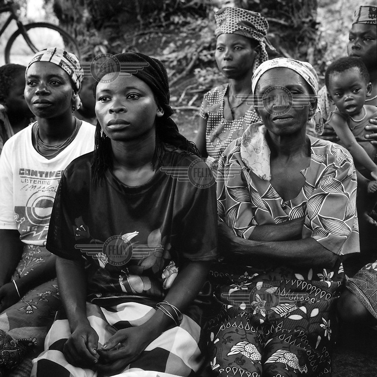 """Women at a village committee (""""the commission for local development"""") meeting in the woods. The assembly comprised of members from the Majole community, which has 697 inhabitants."""