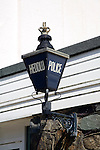 Police blue lamp in English and Welsh