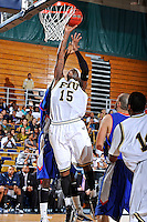 12 November 2010:  FIU's Eric Frederick (15) lays the ball up and into the basket in the second half as the FIU Golden Panthers defeated the Florida Memorial Lions, 89-73, at the U.S. Century Bank Arena in Miami, Florida.