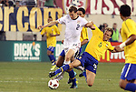 10 AUG 2010: Jonathan Spector (USA) (2) has the ball tackled away by Lucas (BRA) (5). The United States Men's National Team lost to the Brazil Men's National Team 0-2 at New Meadowlands Stadium in East Rutherford, New Jersey in an international friendly soccer match.