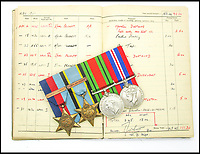 BNPS.co.uk (01202 558833)<br /> Pic: JoePinguey/BNPS.<br /> <br /> Pulfrey's logbook and medals.<br /> <br /> The tragic tale of downed RAF Lancaster bomb aimer and the heartwarming friendship which developed between the farmer who found his body and his grieving family can be told after his medals emerged for sale.<br /> <br /> Flying Officer Leslie Pulfrey, of 103 Sqn RAF Bomber Command was killed when his Lancaster was shot down by a Luftwaffe fighter over the Netherlands on the way back from a raid on a German oil refinery.<br /> <br /> His body was found on 16th June 1944 by a Dutch farmer Gerrit Van Eerden wrapped in an unopened parachute and with bullet wounds to his neck.<br /> <br /> Only one of the crew survived the crash and Pulfrey was laid to rest with five of his comrades in the local cemetery.<br /> <br /> Fly Off Pulfrey's nephew Joe Pinguey, 67, a retired motor mechanic from Penistone, south Yorkshire, is putting his medals on the market with Sheffield Auction Gallery for &pound;1,200.