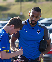 New signing Liam Trotter of AFC Wimbledon with supporters ahead of the pre season friendly 'Cherry Red Records Cup' match between Wycombe Wanderers and AFC Wimbledon at Adams Park, High Wycombe, England on 25 July 2017. Photo by Andy Rowland.