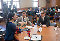 William Huang '15, center, and Christopher Weeks '16 talk with a business professional. Occidental and Scripps College students participate on the final day of The Fullbridge Program's Internship Edge on Jan. 17, 2014 in Dumke Commons of Swan Hall. Students presented their team projects and talked with professionals. The program was hosted by Occidental College in conjunction with Scripps College. 20 students were engaged in the intensive, professionalized, skill-building program which focused on careers in finance, business and entrepreneurship. (Photo by Marc Campos, Occidental College Photographer)