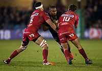 Bath Rugby's Aled Brew is tackled by Scarlets&rsquo; Aaron Shingler and Dan Jones<br /> <br /> Photographer Bob Bradford/CameraSport<br /> <br /> European Champions Cup Round 5 - Bath Rugby v Scarlets - Friday 12th January 2018 - The Recreation Ground - Bath<br /> <br /> World Copyright &copy; 2018 CameraSport. All rights reserved. 43 Linden Ave. Countesthorpe. Leicester. England. LE8 5PG - Tel: +44 (0) 116 277 4147 - admin@camerasport.com - www.camerasport.com