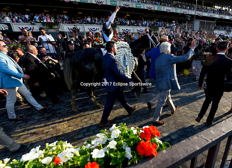 ELMONT, NY - JUNE 10: Jose Ortiz celebrates winning the 149th Belmont Stakes on Tapwrit #2 on Belmont Stakes Day at Belmont Park on June 10, 2017 in Elmont, New York (Photo by Scott Serio/Eclipse Sportswire/Getty Images)