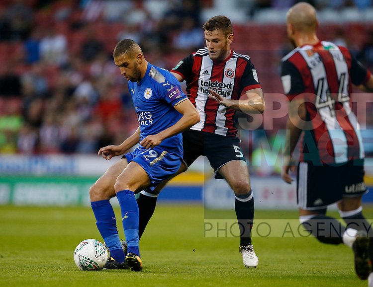Islam Slimani of Leicester City and Jack O'Connell of Sheffield Utd during the Carabao Cup, second round match at Bramall Lane, Sheffield. Picture date 22nd August 2017. Picture credit should read: Simon Bellis/Sportimage