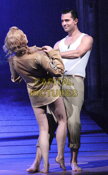 Darius Campbell, Rebecca Thornhill<br /> 'From Here to Eternity' new musical theatre photocall,  Shaftesbury Theatre, London, England, UK, October 16th 2013.<br /> music acting on stage full length costume <br /> CAP/ROS<br /> &copy;Steve Ross/Capital Pictures