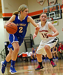 02/05/13--La Salle Prep Falcons guard Sterling Swift (2) dribbles the ball around Gladstone Gladiators guard Alisa Webster (15) in the first half at Gladstone High School....Photo by Jaime Valdez.