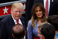 U.S. President Donald Trump and First Lady Melania Trump greet guests at a picnic for military families in Washington, D.C., U.S., on Wednesday, July 4, 2018. Dozens of retired military and national security officers joined the NAACP and the American Medical Association in urging a federal appeals court to uphold a court order blocking Trump's ban on transgender people serving in the military. <br /> CAP/MPI/RS<br /> &copy;RS/MPI/Capital Pictures