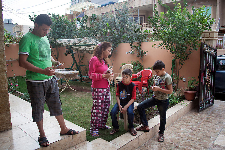 "10/31/14. Erbil, Iraq.<br /> At early morning Suzan spook to Wassam and Milad before they leaving, She said ""Now you are going back to Alqosh and please be good with School and keep study well and be good on the orphanage""."
