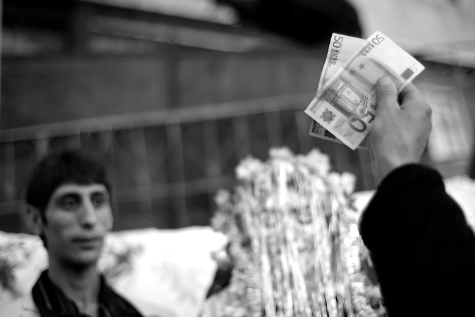 A man announces how much money he will give to Djamal Sirakov and Fatme Ulanova during the celebration of their wedding ceremony in the village of Ribnovo.