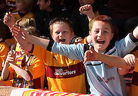Happy Motherwell fans in the Motherwell v St Johnstone Clydesdale Bank Scottish Premier League match played at Fir Park, Motherwell on 28.4.12.