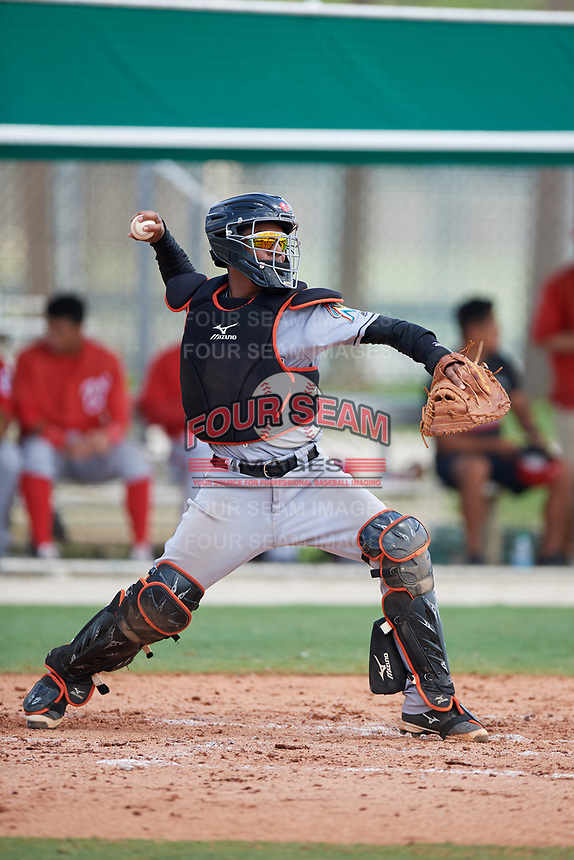 GCL Marlins catcher Pablo Garcia (4) throws to second base during the first game of a doubleheader against the GCL Nationals on July 23, 2017 at Roger Dean Stadium Complex in Jupiter, Florida.  GCL Nationals defeated the GCL Marlins 4-0.  (Mike Janes/Four Seam Images)