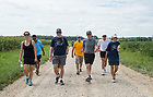 August 14, 2017;  On Day 1 of the ND Trail, Ann Firth, Chief of Staff, (left) Jack Brennan, chairman of the University of Notre Dame's Board of Trustees and University of Notre Dame President Rev. John I. Jenkins, C.S.C., join the pilgrims for a 19 mile trek from Vincennes to Oaktown, Indiana. As part of the University's 175th anniversary celebration, the Notre Dame Trail will commemorate Father Sorin and the Holy Cross Brothers' journey. A small group of pilgrims will make the entire 300+ mile journey from Vincennes to Notre Dame over  two weeks. (Photo by Barbara Johnston/University of Notre Dame)