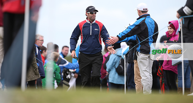 High fives through the gap en route to the 18th for Bradley Dredge (WAL) during Round Three of the 2015 Dubai Duty Free Irish Open Hosted by The Rory Foundation at Royal County Down Golf Club, Newcastle County Down, Northern Ireland. 30/05/2015. Picture David Lloyd | www.golffile.ie