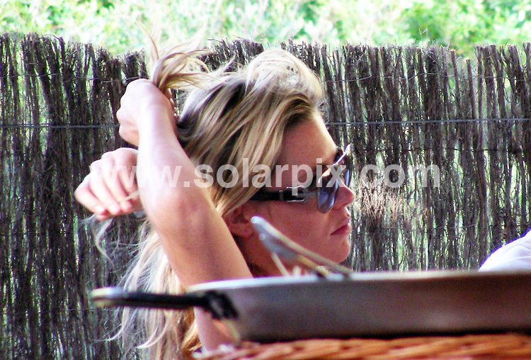 **ALL ROUND EXCLUSIVE PICTURES FROM SOLARPIX.COM**.**WORLDWIDE SYNDICATION RIGHTS**.Pics show England and Liverpool striker Peter Crouch and girlfriend Abbey Clancy having lunch in a beach bar while on holiday in Spain..JOB REF:  6709    OA1        DATE: 23.06.08.**MUST CREDIT SOLARPIX.COM OR DOUBLE FEE WILL BE CHARGED* *UNDER NO CIRCUMSTANCES IS THIS IMAGE TO BE REPRODUCED FOR ANY ONLINE EDITION WITHOUT PRIOR PERMISSION*