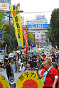 Tokyo, Japan - April 15: A group of people marched against nuclear power plants during a demonstration at Ikebukuro, Toshima, Tokyo, Japan on April 15, 2012. This was the first time in the big city and organized by a local couple, Mr. and Mrs. Makabe. It was promoted via twitter and its blog, and approximately 250 people showed up.