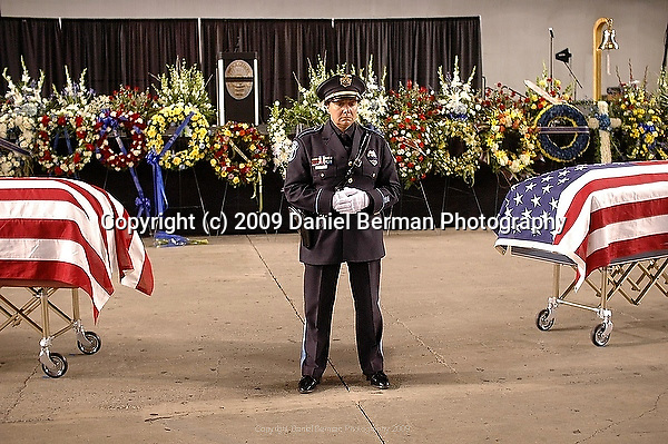 A Washington State honor guard member stands during a memorial service for four slain police officers in Tacoma, WA Tuesday December 8, 2009. The memorial brought an estimated 20,000 police officers and community members to the area.